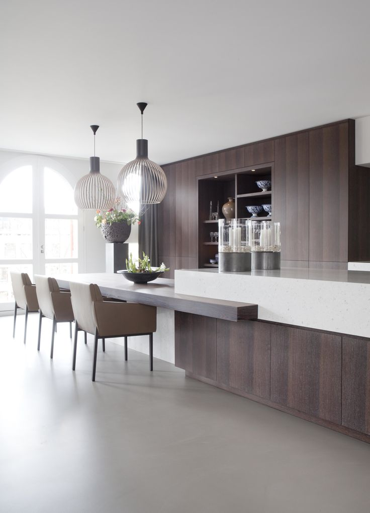 A pair of Octo 4240 from Secto provide this low breakfast bar with some feature lighting