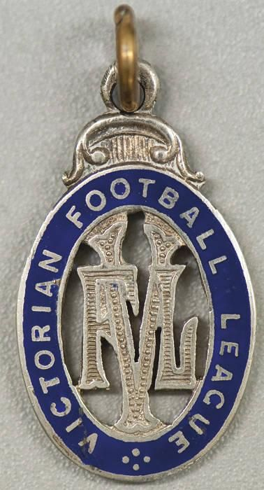 """VFL MEDAL, sterling silver and blue enamel medal with monogram """"VFL"""" in centre, surrounded by text """"VICTORIAN FOOTBALL LEAGUE"""", very attractive and rare. Ex James Crowe, who played 83 games for Carlton 1929-34, and 21 games for Collingwood 1936-37. He played in Carlton's losing 1932 grand final side, but made up for this disappointment by playing in the 1936 Collingwood premiership side. - Current price: $"""