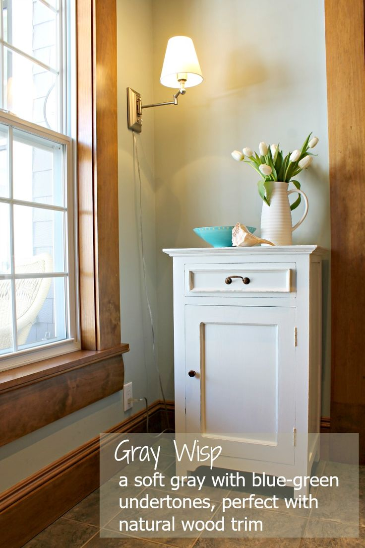 Gray Wisp by Benjamin Moore is a soft, muted gray with a subtle blue-green undertone. Perfect with white or natural wood trim!