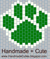 "Here is a simple two color bead woven pattern for a cute cat paw print.  It's a great for any ""Wildcat"" sports fan or kitty lover.  Change t..."