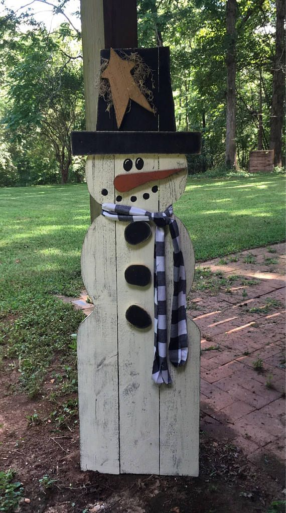 This outdoor snowman is perfect to display outdoors all winter long. He is constructed from 1x6 fence slats, He stands 5 FEET tall and is approx. 18-20 wide. He is painted with Glidden exterior paint and stressed for that rustic country look. His star, nose, hat brim and buttons are also cut from the same 1x6 fence boards. He is accented with a fleece scarf and spanish moss. These are one of my personal favorites. They do not have a base which make it easy to display them any where they can…