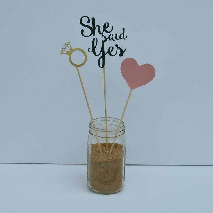 These cute centerpieces are perfect for an engagement party or bridal shower. Use them to decorate the food table, or gift table, or you can even use them as ph