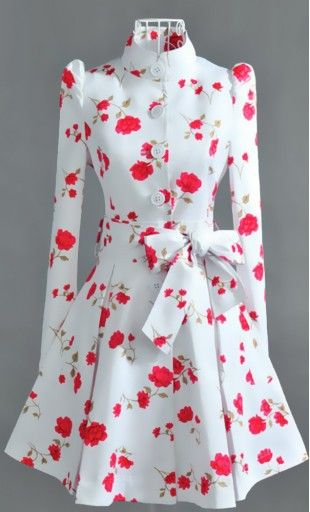 Vintage trench coat with wide collar and bubble sleeves matched with an elegant floral print and matching belt!