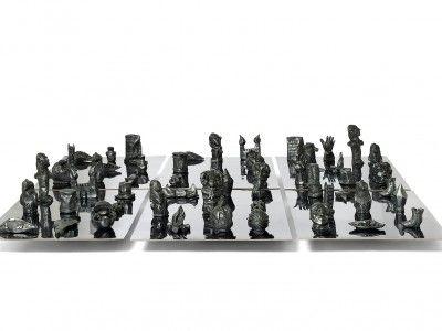 Ida Kvetny, Symbolic Cabinet, 2014, Plaster and Steal-grey graphite on MDF.  Installation consist of 54 unique skulptures. Courtesy: Galleri Christoffer Egelund