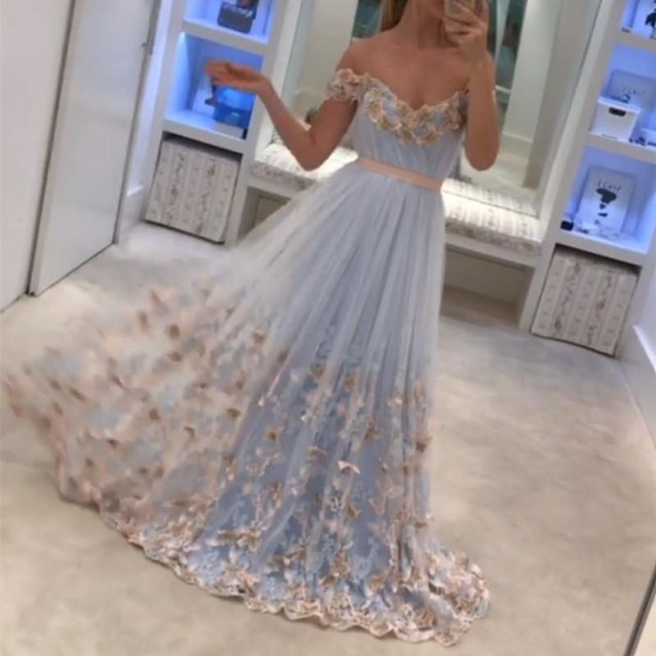 Dresses Video Shows  Item Description : A Glamorous Form Tulle Floor LengthDress Featuring A V-neck With Butterfly Lace Embroidery. Perfect For Prom,Evening,