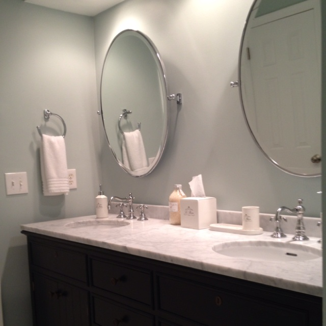 Double vanity, faucets, oval pivot mirrors and bath