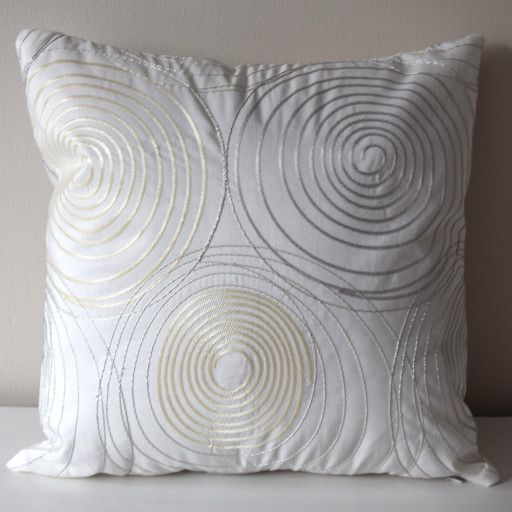 This elegant pillow cover is made of a white sateen fabric, which is decorated with silver/cream lurex embroidery. The lurex threads form circles on the pillow. Thanks for this luxurious embroidery on the fabric, this pillow case will give an unique look to your room.   Some details: - it measures 18x18 inches and I have 2 pc of it - it has a hidden zipper at the bottom - it is without an insert, but as it is a standard size, you can buy it easily in any fabric store or in other etsy sho...
