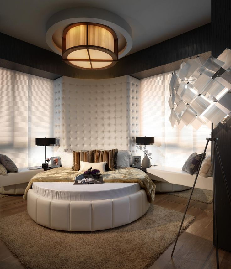 luxurious white and gray favorite interior design bedroom ideas with comfortable round shaped bed furniture that have bedding complete with the pillows and