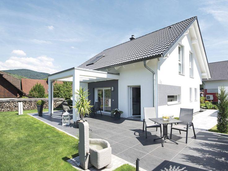 Weber Haus - Ein liebevoll durchdachtes Haus, das in einem freundlichen Gelbton erstrahlt und jedem Familienmitglied ausreichend Freiraum bietet.