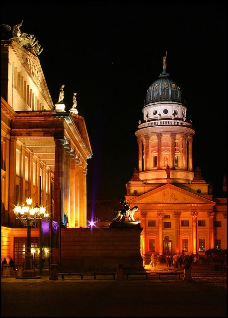 Konzerthaus and French Cathedral at Gendarmenmarkt in Berlin, illuminated during the Festival of Light