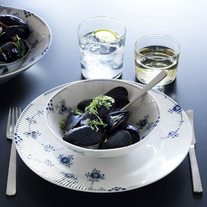 Table is set with Kay Bojesen Grand Prix cutlery; dinner knife and dinner fork. Blue Elements in the 2012 Royal Copenhagen Catalogue. Kay Bojesen Grand Prix cutlery/flatware. Danish Design.