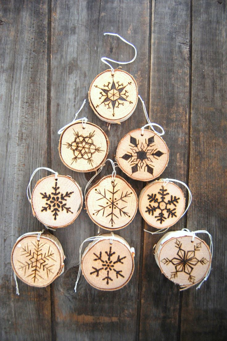 Wood burned Christmas tree ornaments snowflakes holiday Christmas ornament snowflake rustic Vermont birch wood unique snowflake design by REEckerson on Etsy https://www.etsy.com/listing/212134174/wood-burned-christmas-tree-ornaments