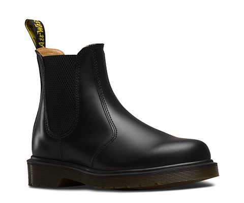 Our classic Chelsea boot in signature Dr. Martens smooth leather: durable, with a smooth finish. Made with Goodyear welt, the upper and sole are heat-sealed and sewn together. Care Instructions: Clean away any dirt using a damp cloth and allow to dry. Apply a correctly coloured wax-based shoe polish to restore shine