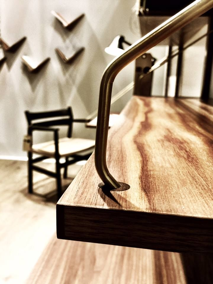 Detail shot of the ROYAL SYSTEM shelving with the BM2 Chair and the CADOVIUS BUTTERFLY SHELF shelves in the background at Salone del Mobile April 2015 #dk3 #danishdesign #danishlivingroom #danishmidcentury #salonedelmobile #borgemogensen #poulcadovius #butterflyshelf #bm2 #royalsystem #1948 #1958