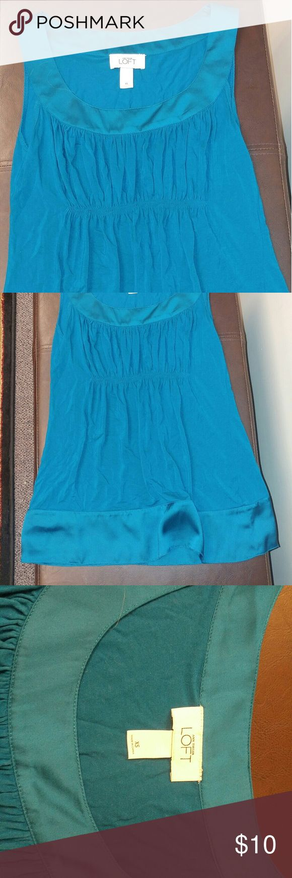 Ann taylor loft teal shirt size xs Ann taylor loft teal top. Size xs. Made of rayon, lycra, and spandex. Length 26 inches. Underarm 15 inches across. ann taylor loft Tops