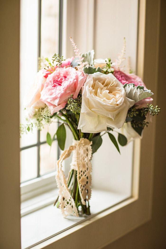 A vintage inspired bridal bouquet with 'Pink O'Hara' & 'White O'Hara' garden roses! This bouquet smelled heavenly!  Photo: www.geoffwilkings.com  @gwilkingsphoto  Planning:www.knotplanning.ca  Bouquet: www.flowersbyjanie.com  #realweddingcalgary #Calgaryweddingflorist #FlowersbyJanie #pinkohara #gardenrosebouquet #lace