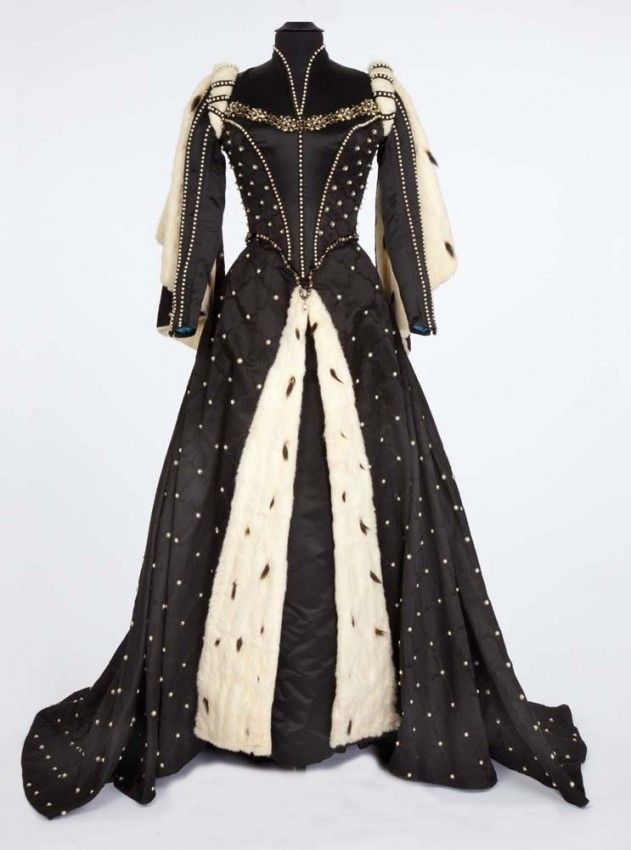 """Lana Turner """"Diane de Poitiers – Countess de Breze"""" Black satin period gown with ermine cape designed by Walter Plunkett from Diane. (MGM, 1..."""