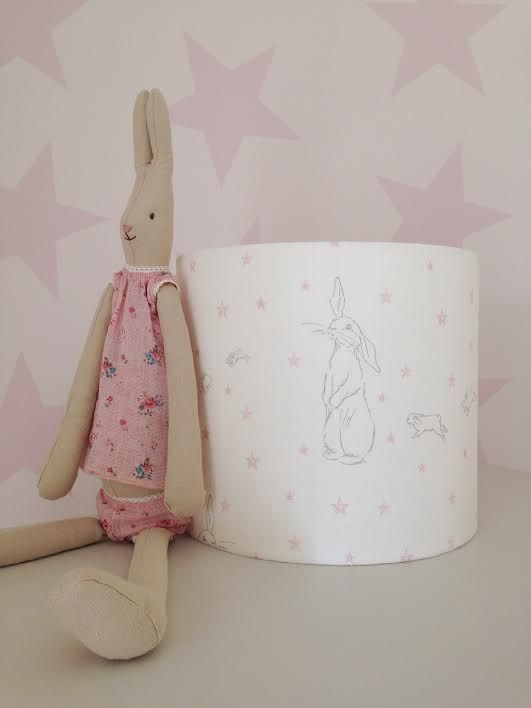 A gorgeous drum lampshade handmade in this adorable Peony & Sage Rabbit All  Star linen union blend on oyster white base cloth, featuring a vintage  original rabbit and her little ones following behind.  All lampshades are lovingly handmade to order in a range of sizes as listed  below and available to use as ceiling pendant or for a lamp base.  All of our lampshades are backed with flame retardant PVC which has been  tested and passed the glow wire test carried out by the Lighting ...