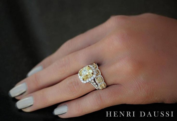 Stand out from the rest with a #gorgeous yellow #diamond wedding set by Henri Daussi. #fashion #style #jewelry #jewellery Henri Daussi diamond engagement ring and wedding band.