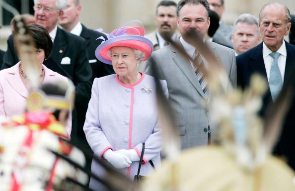 Queen Elizabeth II and Prince Philip watch a display by Native American Indians at the State Capitol Building on the first day of their USA tour on May 3, 2007 in Richmond, Virginia