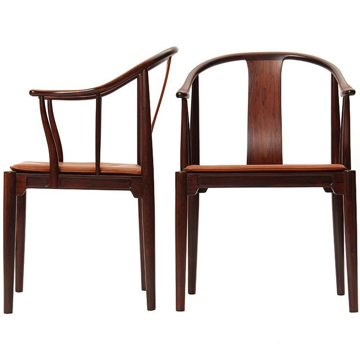 "Pair of rosewood Chinese Chairs by Hans J. Wegner  Denmark  1960's  A rosewood ""Chinese"" chair with leather seat pad. Design Hans Wegner manufactured by Fritz Hansen."