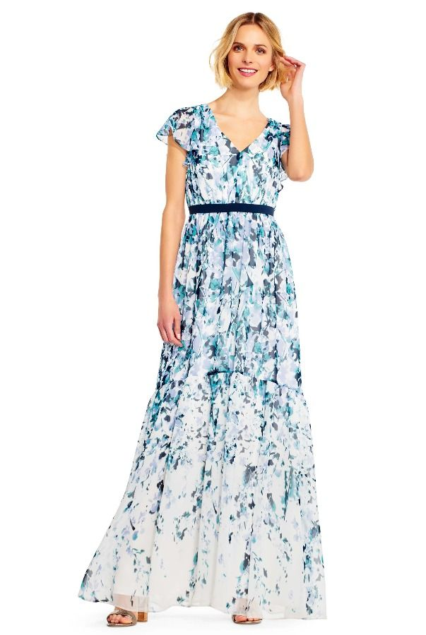 Adrianna Papell Watercolor Floral Chiffon Maxi Dress Flutter Slve | Poshare Formal or casual, this maxi dress does no wrong. This long chiffon dress features all over floral print, fluttering sleeves, a flowing skirt, and a contrast ribbon at the waist that defines the figure. This floral print maxi dress is finished by a hidden zipper back. Worn with flat sandals or heels, this style will win best dressed guest at every party it attends.