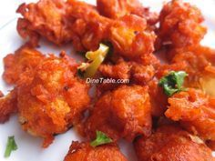 DineTable.com - Chilly Gobi 65 or Gobi 65 or Cauliflower 65 is a very popular Indo-Chinese dish. See How to Make Chilly Gobi 65 - Recipe, Ingredients, Easy Method Steps