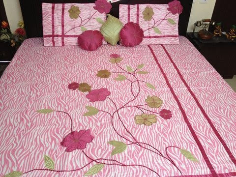 Pink coloured bed cover set from Zafraan. Made of polyester, this 6-piece set comprises of 1 bed cover, 2 pillow covers and 3 cushions.