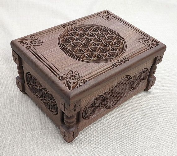 Flower of Life - Small Jewelry Box with carved oriental and arabesques ornaments and motifs made of selected wood (American walnut), inside is upholstered in white velvet. Outside is varnished with environmentally friendly polyurethane resins. Brass hardware adds an elegant finishing touch to the whole design.    Dimensions:  width 19 cm  length 26 cm  height 14 cm  all size are within +/- 0.5 cm    It can be done in different wood, finishing and size on request.  Can be chosen differently…