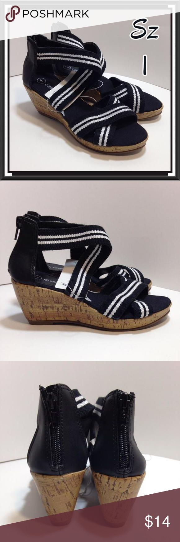 NEW Black & White Wedge Sandals Youth Girls Size 1 Black and white stripe strappy sandals with faux leather heels. Cork wedge soles with black fabric cushioned insoles. Vertical zippers up the back from heel to ankle. Cherokee, Youth Size 1 Cherokee Shoes Sandals & Flip Flops