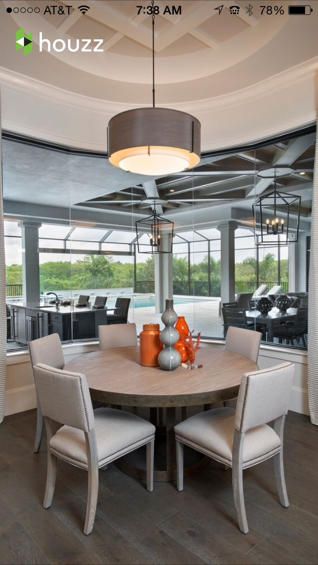 This Dining Area Showcases A Light Color Palette And Combines Off White Soft Grays With Pop Of Orange Located In Naples Florida The British West