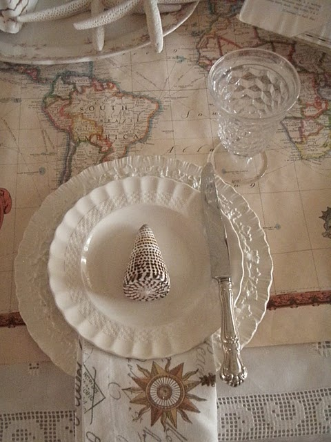 """one of my favorite ideas to use nautical charts as part of an elegant tablescape"""