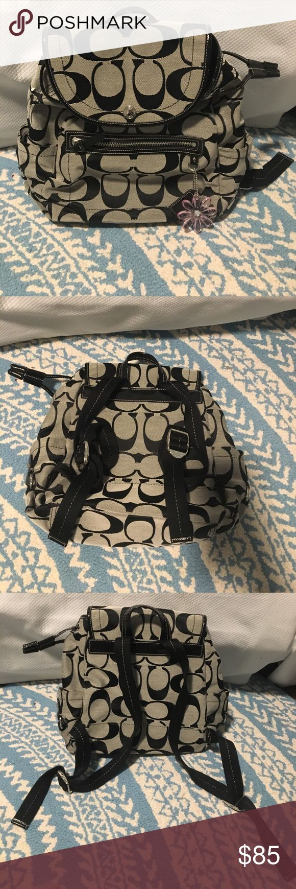 Coach Backpack NWOT Black and gray Coach backpack. Never used before - in perfect condition. About 12 inches long. Adjustable backpack straps and has a handle at the top if you don't want to wear it as a backpack. Coach flower keychain included on it and can be removed. Inside has one zipper pocket and 2 open pockets. Outside has one zipper pocket ✨ Coach Bags Backpacks