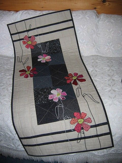 gray and pink table or bed runner.
