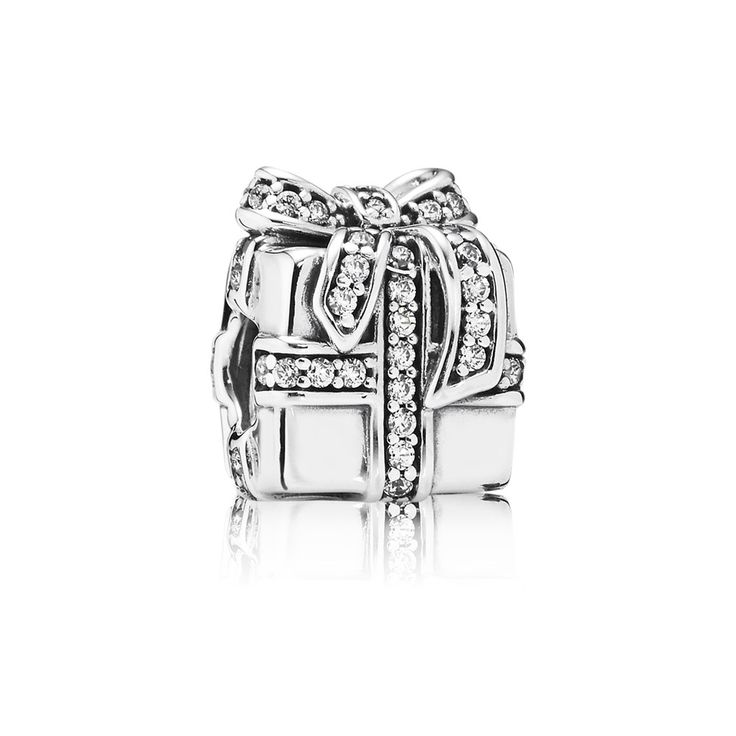 Pandora Sparkling Present Charm Inspired by the season of giving, treat a loved one to a sparkling surprise this christmas with this stylish charm from PANDORA, beautifully crafted from sterling silver with glistening cubic zirconia stones carefully hand-set in the bow detail for a truly special finish. 791400CZ £60.00 http://www.argento.co.uk/en/Pandora-Sparkling-Present-Charm/m-48712.aspx