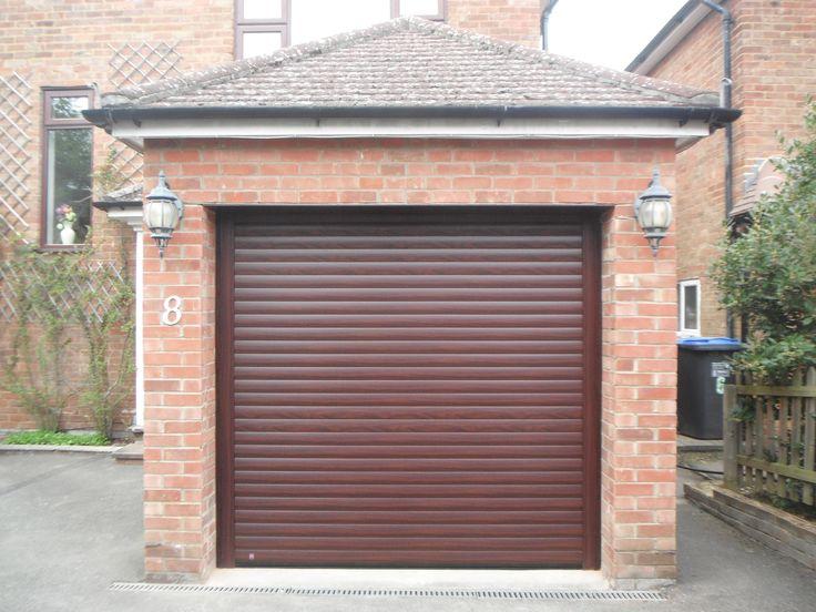 Hormann Rollmatic Garage Door In Rosewood Decograin Finish.