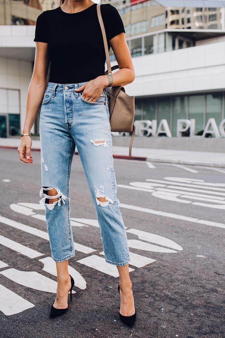 Woman Wearing Short Sleeve Black Bodysuit Levis Wedgie Straight Leg Ripped Jeans…