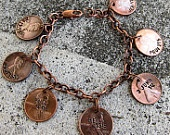 Penny Charm Bracelet - Hand stamped pennies from important years (birthday, anniversaries, etc.). I love this idea!