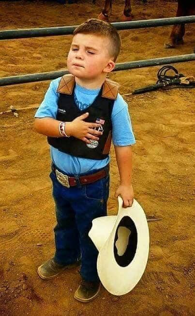 This 3 year old boy during the National Anthem. I love this picture!