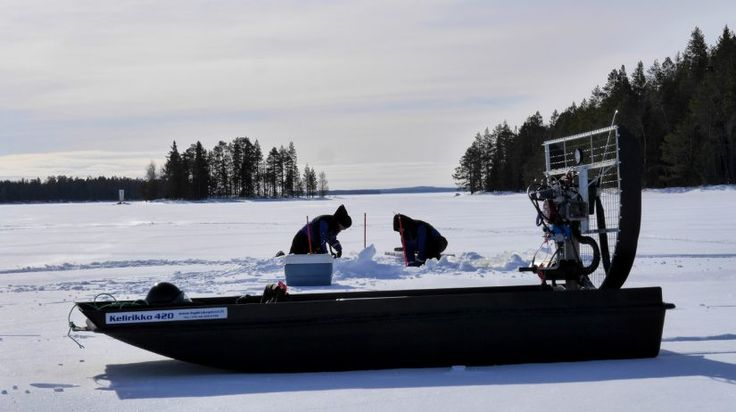 Fishermen winter fishing with a hydrocopter in Lake Miekojärvi in Pello in Finnish Lapland