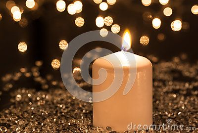 White candle and small decoration lights