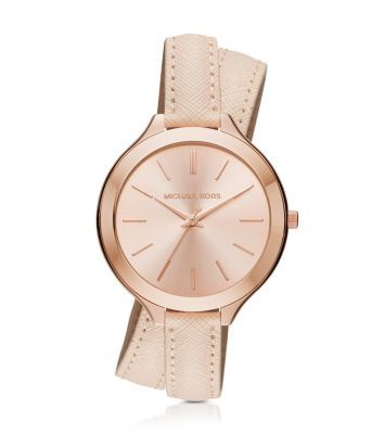Exclusively Ours in the U.S. in Michael Kors stores and on michaelkors.com. Double your wrist's chic factor with the elegant Slim Runway watch. In radiant rose gold-tone stainless steel and luxe leather, this watch offers up a feminine take on a true classic. The buckled bracelet wraps for a layered look that reads cool and casual.