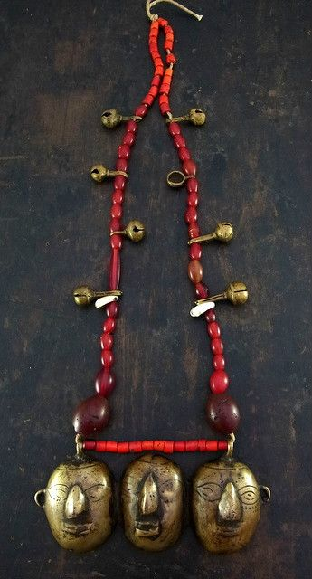 India | Old Naga tribe head hunters necklace; old Venetian white hearts, carnelian, shell and glass beads are combined with brass bells and central brass pendant   | ¥ 250,000
