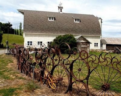 love this-- old wheel rims/farm implements fence: Gardens Fence, Wagon Wheels, Ideas, Unique Fence, Upcycled Fence, Farms Random, Children, Wheels Fence, Rusty Farms
