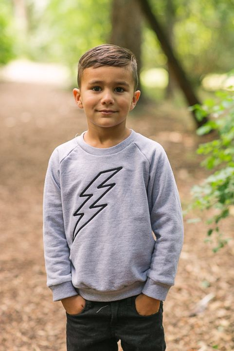 Handsome, handsome, handsome, in hand-embroidered Emerson Apparel.