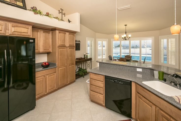 Maple cabinets with crown molding, Corian counters, and ...