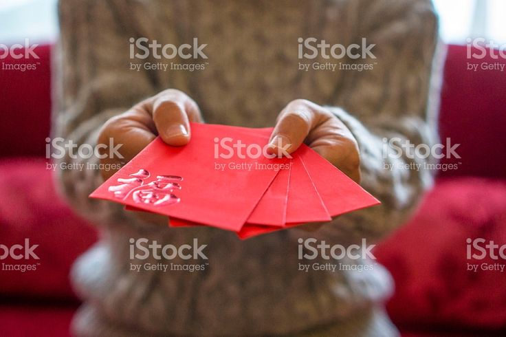 giving red envelope of money on holiday royalty-free stock photo