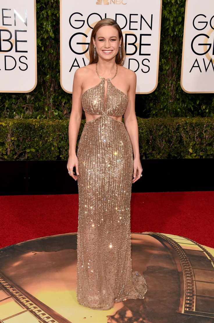 Brie Larson in Calvin Klein ~ Wearing a gold dress on the red carpet is nothing new, but the custom glittery gown is a solid choice for Larson  |  The Best Dressed at the 2016 Golden Globes  |  ELLE.com