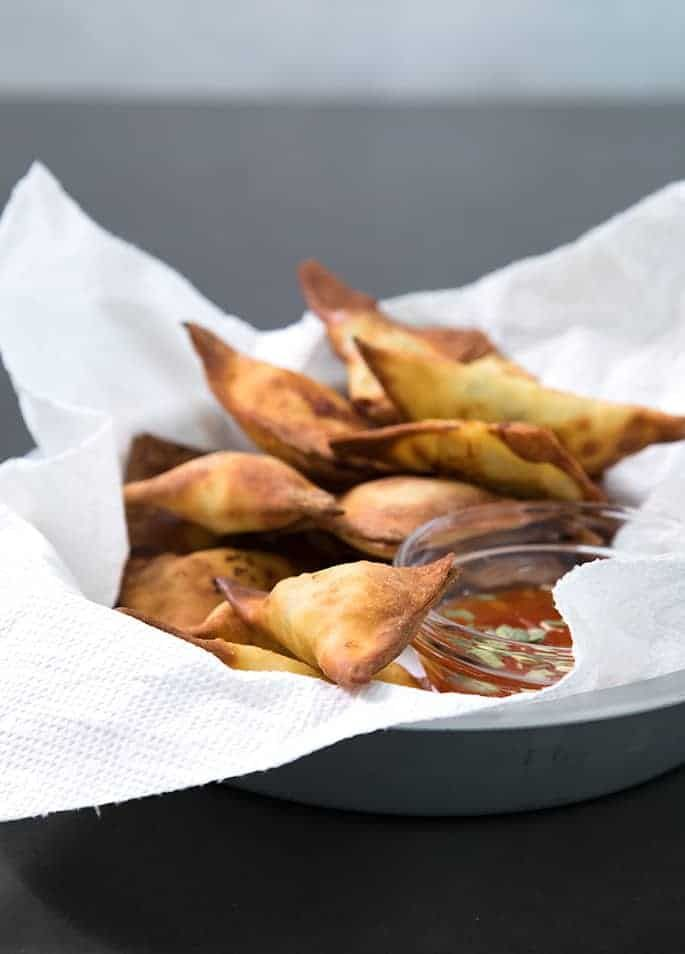 These Air Fryer fried wontons are made with very little oil but are still super crispy and crunchy. They'll be the first thing to go at a party!