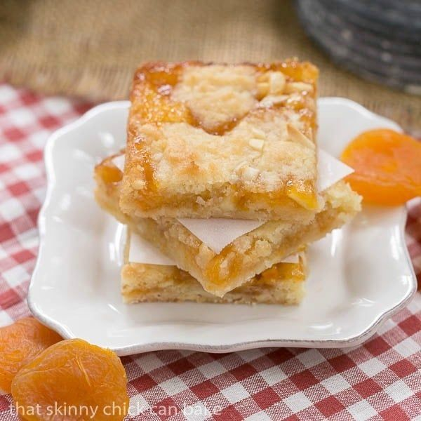 Layers of coconut and almond filled cookie dough and apricot preserves make these Apricot Bars scrumptious and unforgettable.